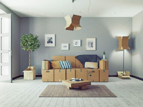 Photo of furniture made with cardboard boxes to symbolise moving furniture to a new home